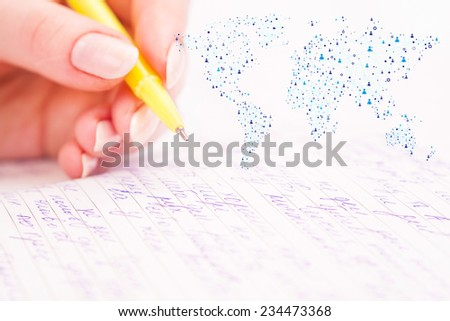 Business woman writing in notepad and added graphic global connection icon - stock photo