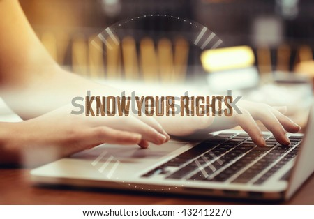 Business woman writing Know Your Rights on the computer - stock photo