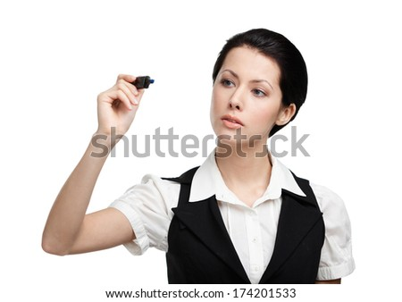 Business woman writing on the invisible screen with marker, isolated on white. Target achievement