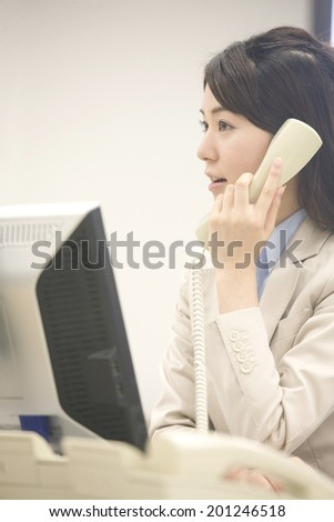 Business woman you have phone support - stock photo