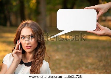 Business womanl talking with cell phone in park - stock photo