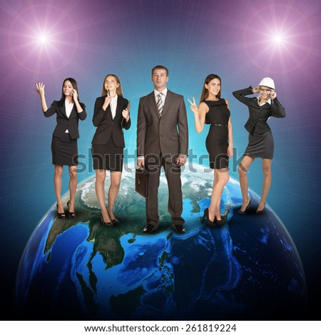 Business women and men in suits, smiling and looking at camera. Against the background of globe and glowing spotlight. Elements of this image furnished by NASA - stock photo