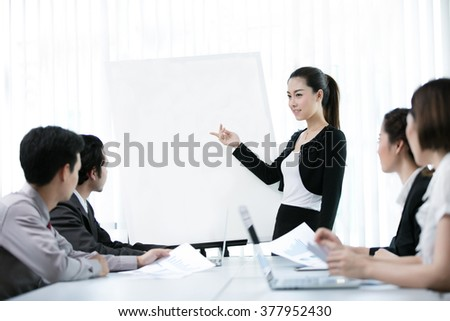 Business women are offered a job as a graph at a meeting of the company
