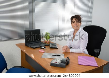 Business  Women   at the office at her desk