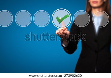 Business women  check mark on virtual screen. Finger on a checklist box and ticking. Business technology concept. Isolated on blue. Stock Image - stock photo