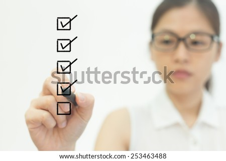 Business women drawing in front of screen