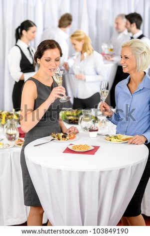Business women drink aperitif during company seminar meeting - stock photo