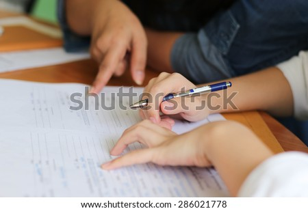 Business Women filling a Paperwork for agreement - stock photo