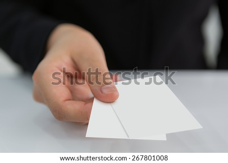 Business Women hand holding blank paper business card  ( with separate layer clipping path : Finger,Card01,Card02 )