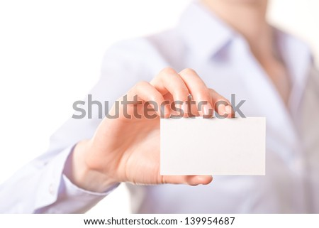 Business women handing a blank business card