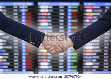 business women handshake on blurred business board, business hands concept. - stock photo