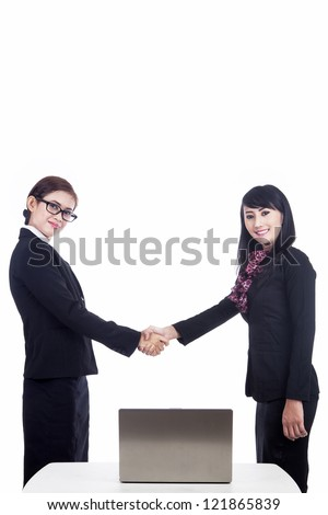 Business women partnership with laptop isolated in white