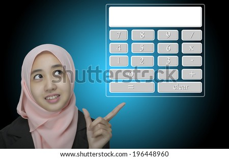 business women pointing at virtual calculator - stock photo