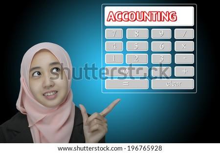 "Business Women pointing virtual calculator interface written ""Accounting"" - stock photo"