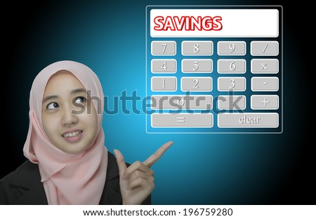 "Business Women pointing virtual calculator interface written ""Savings"" - stock photo"