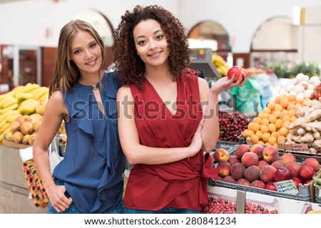 Business women presenting their organic greengrocer - stock photo