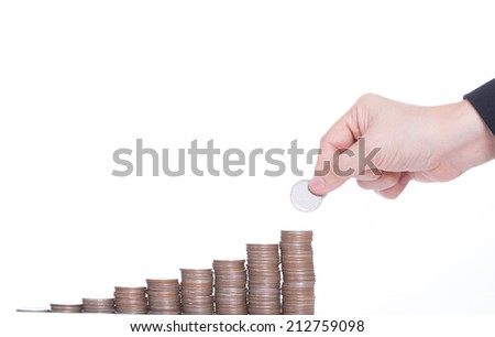 Business women put coin stack money for money growth concept - stock photo