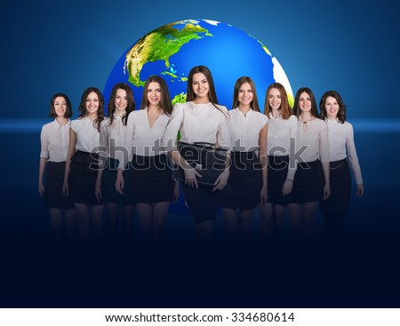 Business women stand on the blue background and big earth behind them. Elements of this image furnished by NASA - stock photo