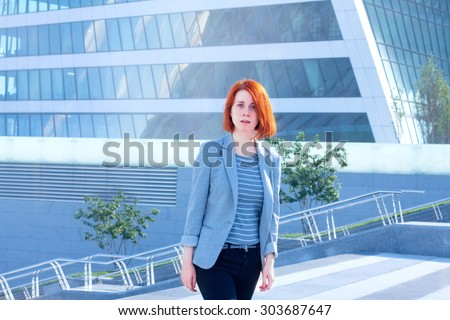 Business women walking down the street on a background of a skyscraper
