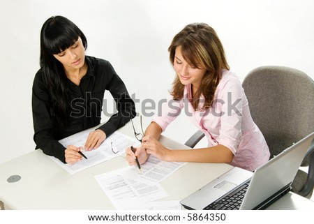 business women  with documents and laptop - stock photo