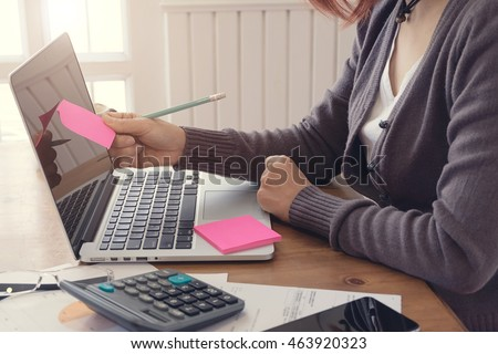 Business Women working at office with laptop and documents on his desk