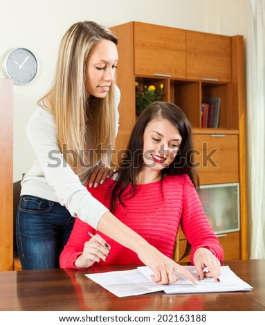 business women working with paper at the table