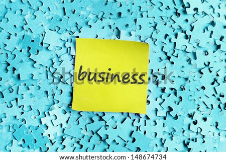Business word on puzzle background  - stock photo