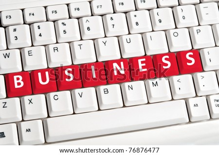Business word on white keyboard