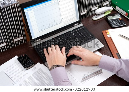 Business working - manager works in the office until late hours with documents, office work,