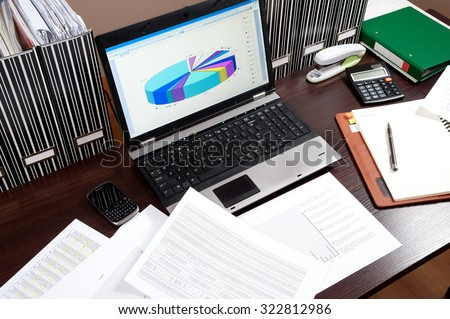 computer desk office works. business working - manager works in the office until late hours with documents, work computer desk a
