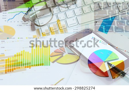 business workplace and computer and printed data sheet