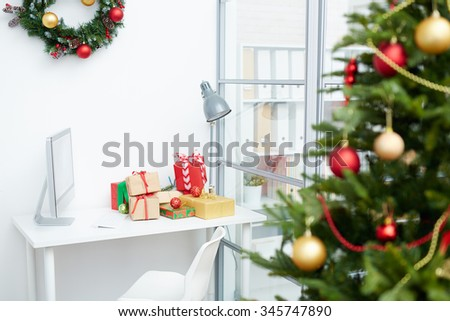 Business workplace with gift-boxes on Christmas day - stock photo