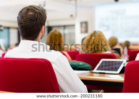 Business workshop and presentation. Audience at the conference room. - stock photo