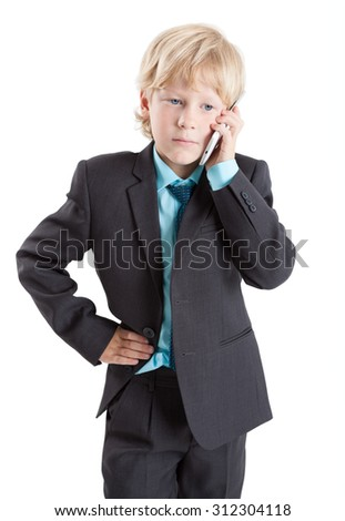 Business young boy in suit and tie speaking with cellphone, isolated on white background - stock photo