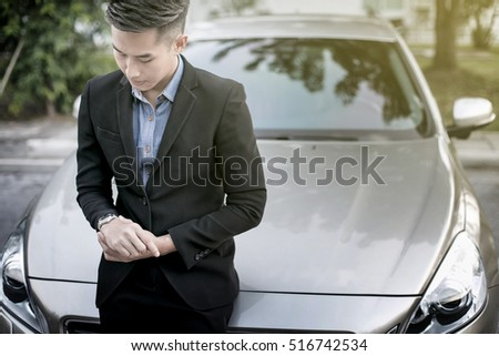 Business young man with his car