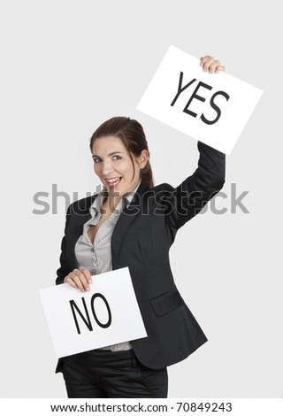 Business young woman choosing the Yes choice, over a white background