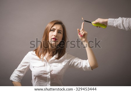 Business young woman having a brilliant idea. Business, energy and environment concept - woman pointing at fire.  Burning finger. Business and education concept - stock photo
