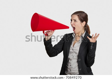 Business young woman speaking to a megaphone, isolated on white - stock photo