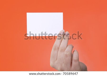 Businesscard in hand on red