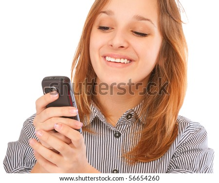 Businessgirl sending a text message with her phone, isolated on white background. - stock photo