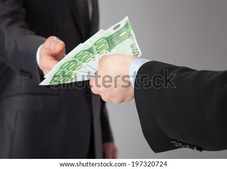 Businessman accepting money offer on grey background - stock photo