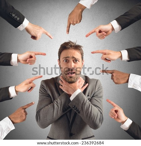 Businessman accused and insulted by his team - stock photo