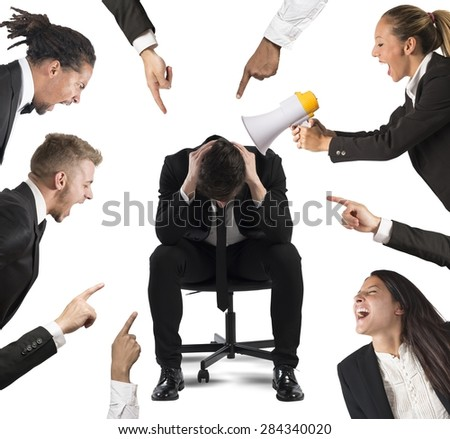 Businessman accused by his colleagues at work - stock photo