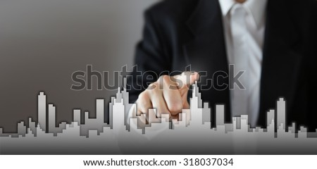 Businessman Activate Growth Process, choosing house, real estate city concept. Skyline Hand pressing the house icon on virtual screen. Business, technology, internet and networking concept. Copy space