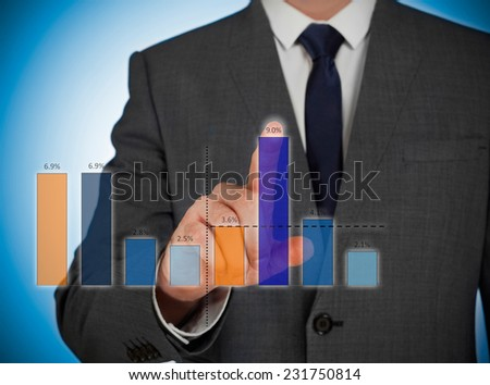 Businessman adjusting a virtual graphic - stock photo