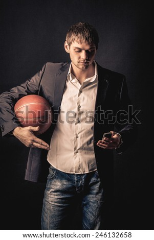 businessman after work day want to go to the basketball match - stock photo