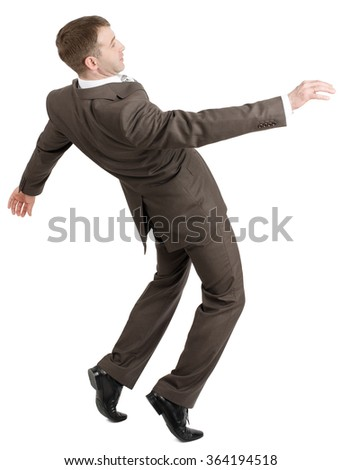 Businessman almost falling back