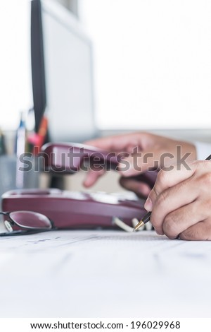 Businessman analysis charts on the paper reported. - stock photo