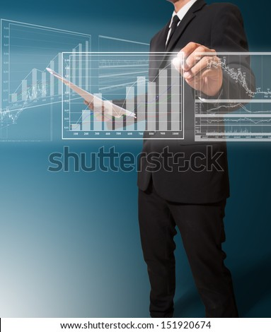 businessman analyze graph - stock photo