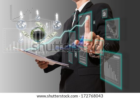 businessman analyze graph with technology